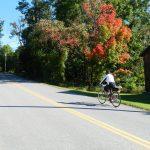 Classic Vermont Biking Tour, Biker on Vermont road