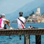 Gateway to the Dolomites: Biking Bolzano to Lake Garda - Bikers on Pier