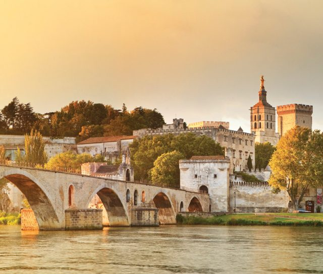 The old Pont Sant Benezet on the Rhone river with Pope Palace