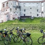 Poland: Cycling Through The Old World - VBT bikes in front of ruins