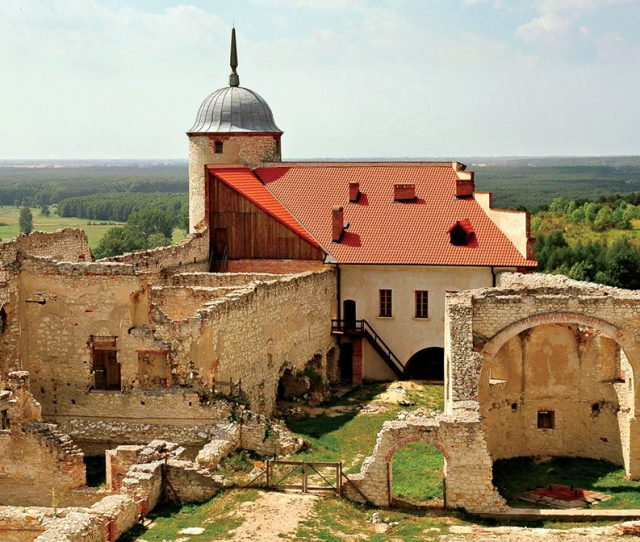 see ancient Polish building on your bike adventure