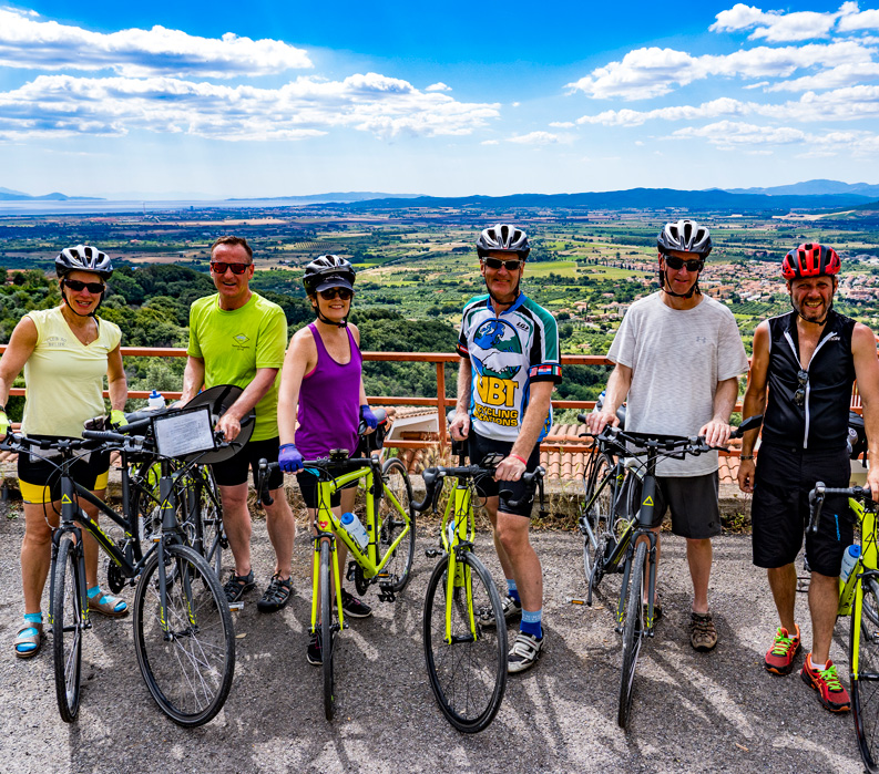 The Tuscan Coast, Italy. Group with bikes.