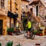 The Tuscan Coast, Italy. Stone buildings and bikers.