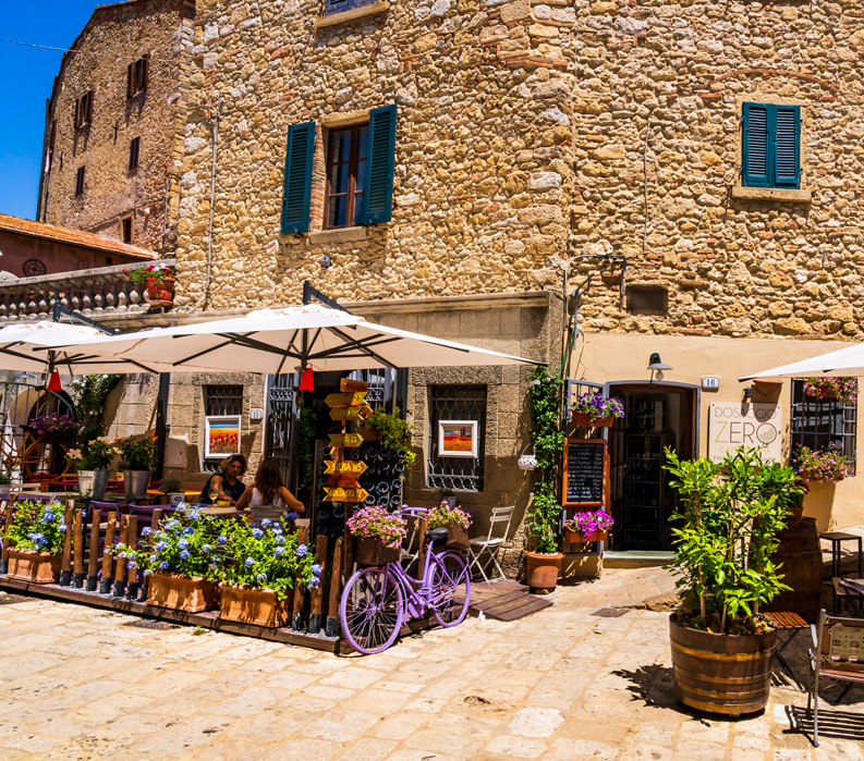 The Tuscan Coast, Italy. Photo of cafe in town.