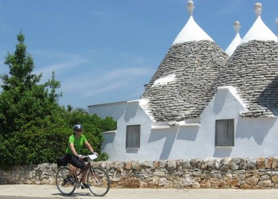Trulli_Anne biking past Trulli a