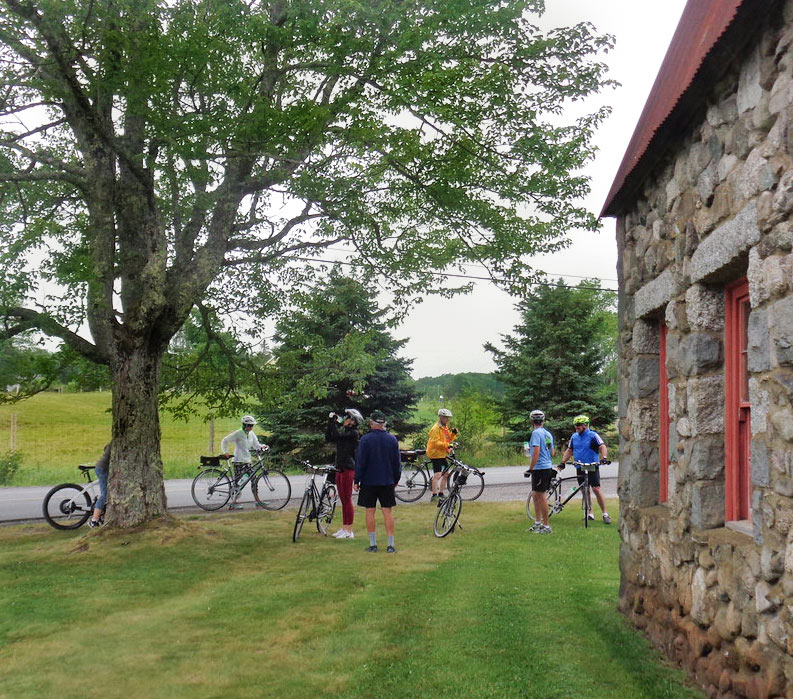 Bikers on a water stop on Acadia Bike Tour